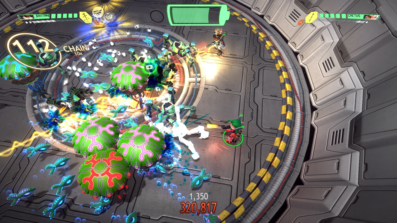 A screenshot from the game Assault Android Cactus. An incredibly chaotic moment in the game as creatures, spiderbots all Duke it out against the player in an oval arena. Floating text indicates that the player has earned a 112 chain of enemies shot bonus.