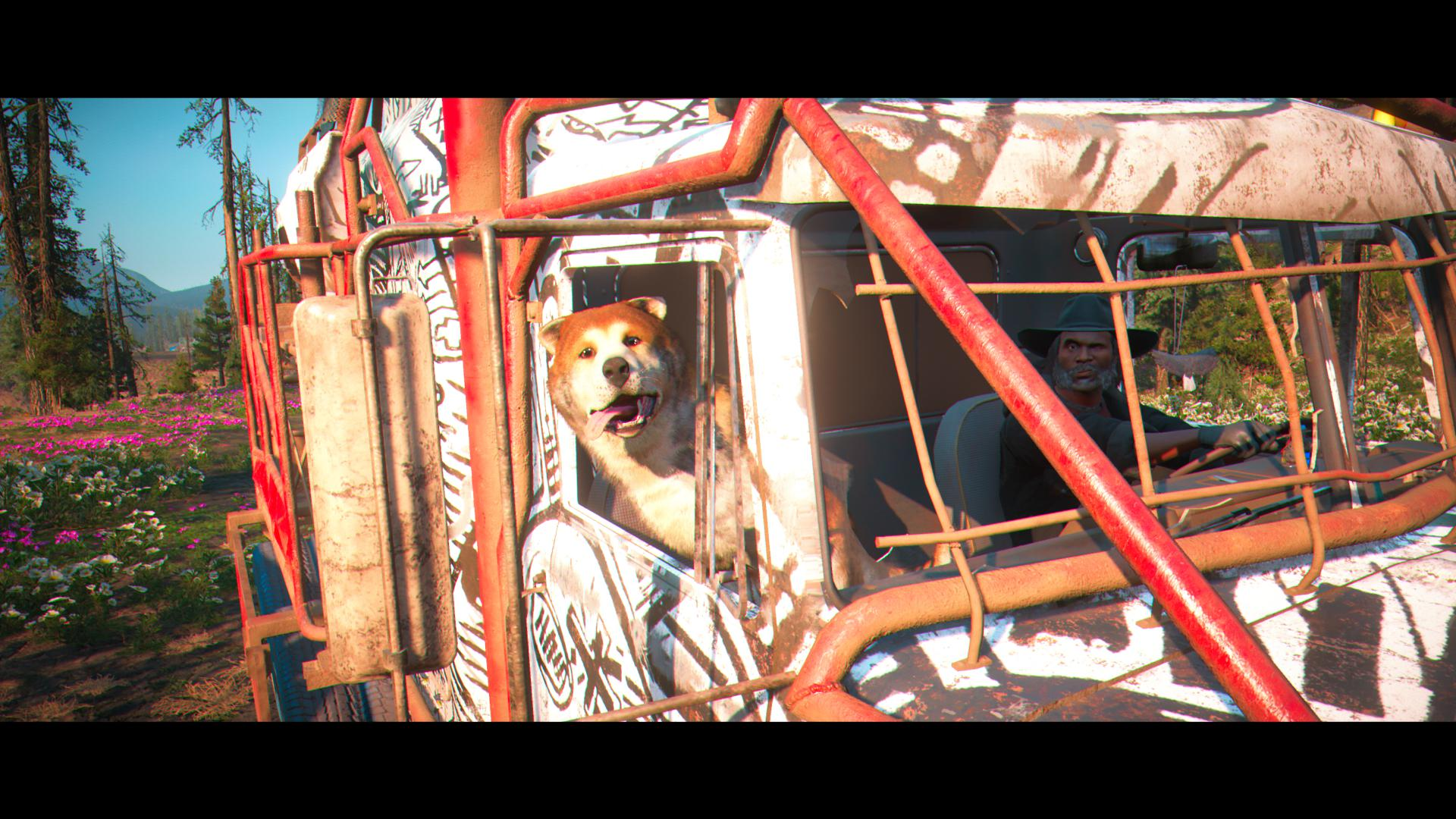 The dog looks out of the window of a van, their tongue is sticking out.