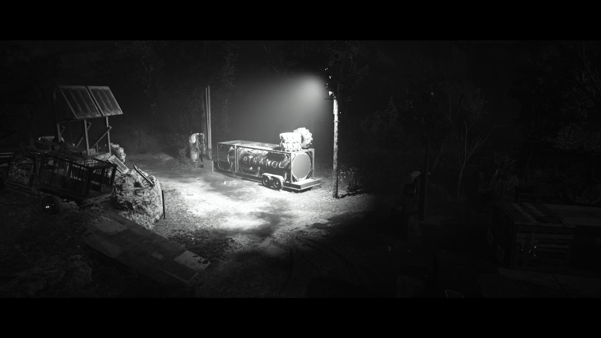 A black and white mysteriously lit shot of a power generator at night.