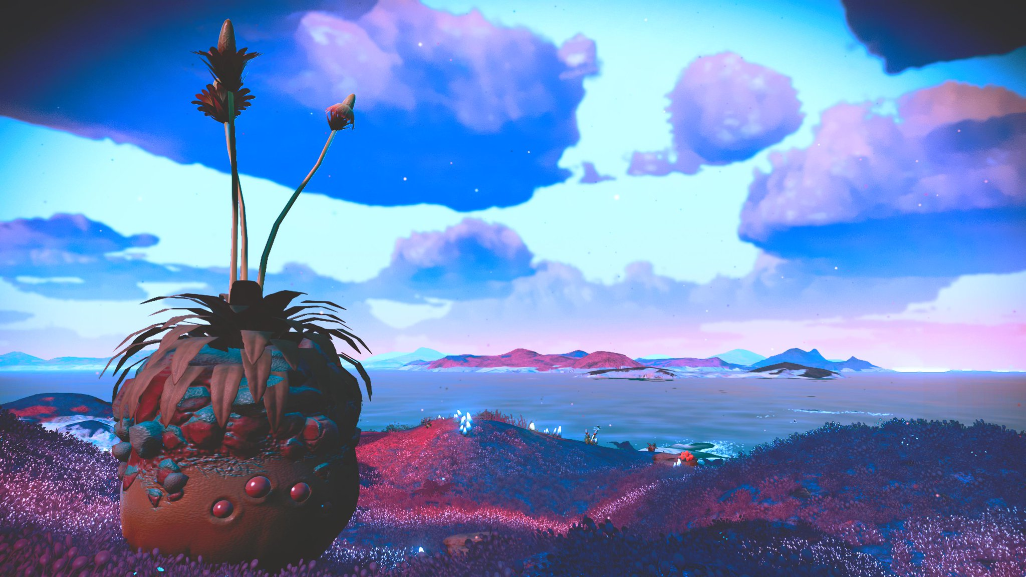 A pineapple creature looks out to a vaporwave sea.
