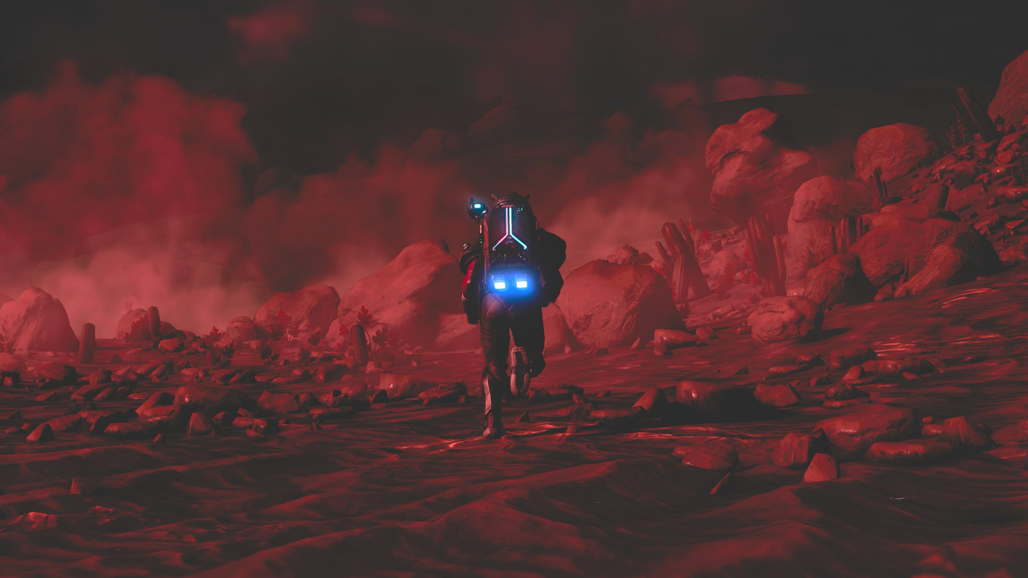 An astronaut runs through a storm covering a red planet, mist fills the air and the only light is from the glow of the astronauts backpack.