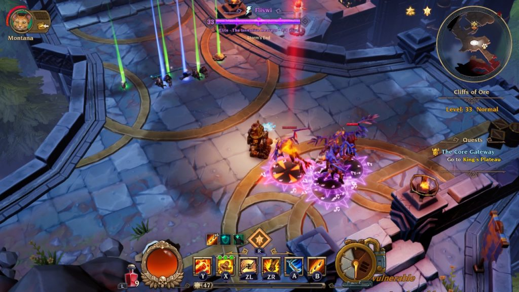 A screenshot from the game Torchlight III. It's a stone dungeon with gold leaf motifs on the floor. There's a fight giving on and some glowing loot dropped in one spot, criminally not picked up already by the player.