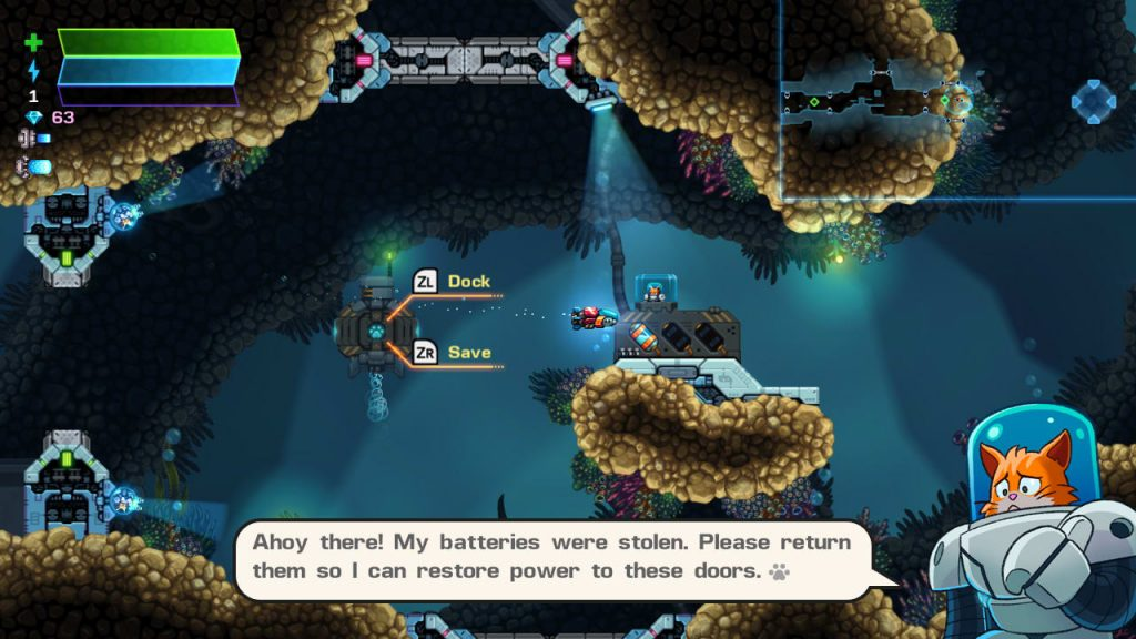 The player by an underwater docking station. A cat in spacey futuristic diving gear is asking the player to find some batteries.